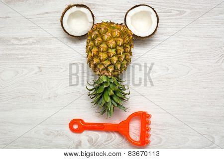 Coconut and pineapple on a white wood table