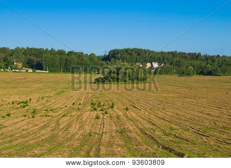 Plowed field in the countryside with furrows