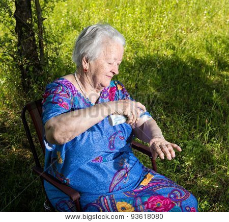 Old Woman Spraying Insect Repellent