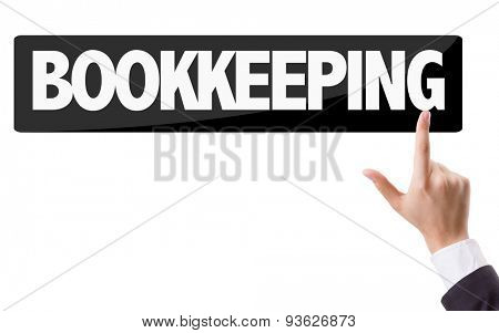 Businessman pressing button with the text: Bookkeeping