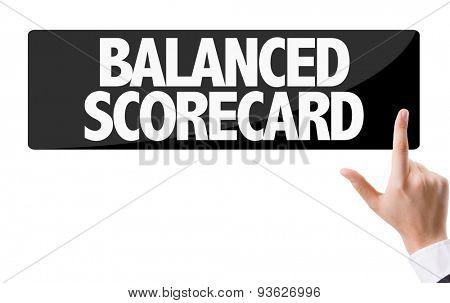 Businessman pressing button with the text: Balanced Scorecard