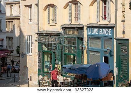 PARIS, FRANCE - SEPTEMBER 8, 2014: Cafés and restaurants at the Montagne Sainte Genevieve street in Paris near Sorbonne and Patheon