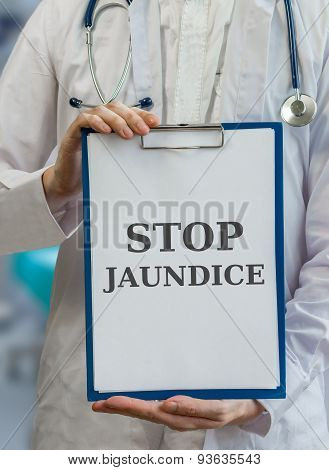 Doctor Holds Clipboard With Stop Jaundice Written