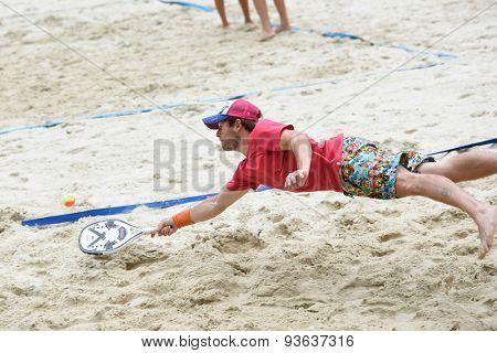 MOSCOW, RUSSIA - MAY 31, 2015: Svyatoslav Tektov in the match of Russian beach tennis championship. 120 adults and 28 young athletes compete in the tournament