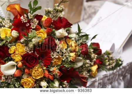 Brides Bouquet With A Guest Book In The Background