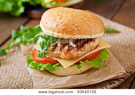 Sandwich with chicken burger, tomatoes, cheese and lettuce