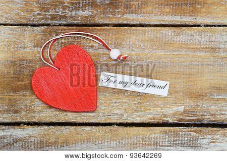 For my dear friend card with red wooden heart on rustic wood