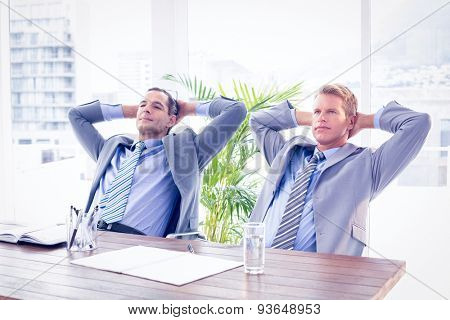 Businessmen relaxing at workin the office