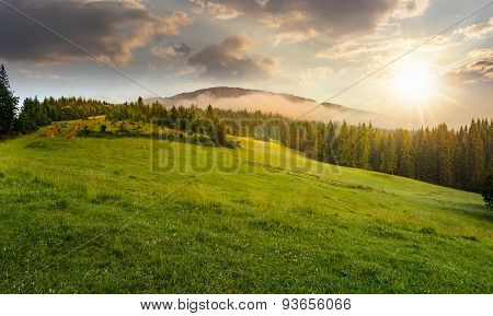 Fog Around The Mountain Top At Sunset
