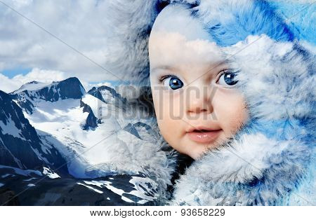 Double exposure of a beautiful baby girl wearing fur coat and Canada's snow covered Rocky mountains.