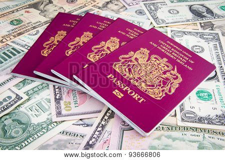UK Passport on a pile of US Dollars