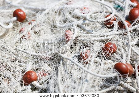 Close-up of fishing net with red floats