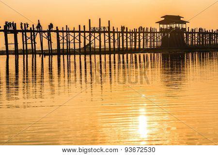 U bein wooden teck bridge silhouetted at dusk in Amarapura, Myanmar (Burma)