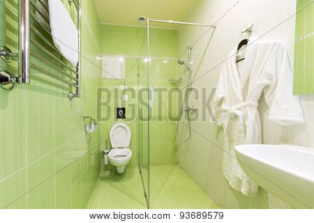 ADLER, RUSSIA - JULY 22, 2014: Interior of a green  hotel room bathroom in Shine House hotel