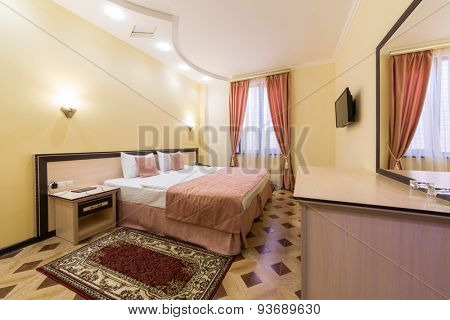 ADLER, RUSSIA - JULY 22, 2014: Interior of a hotel room with a huge bed in Shine House hotel