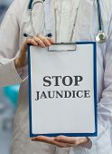 Doctor holds blue clipboard with stop jaundice written poster