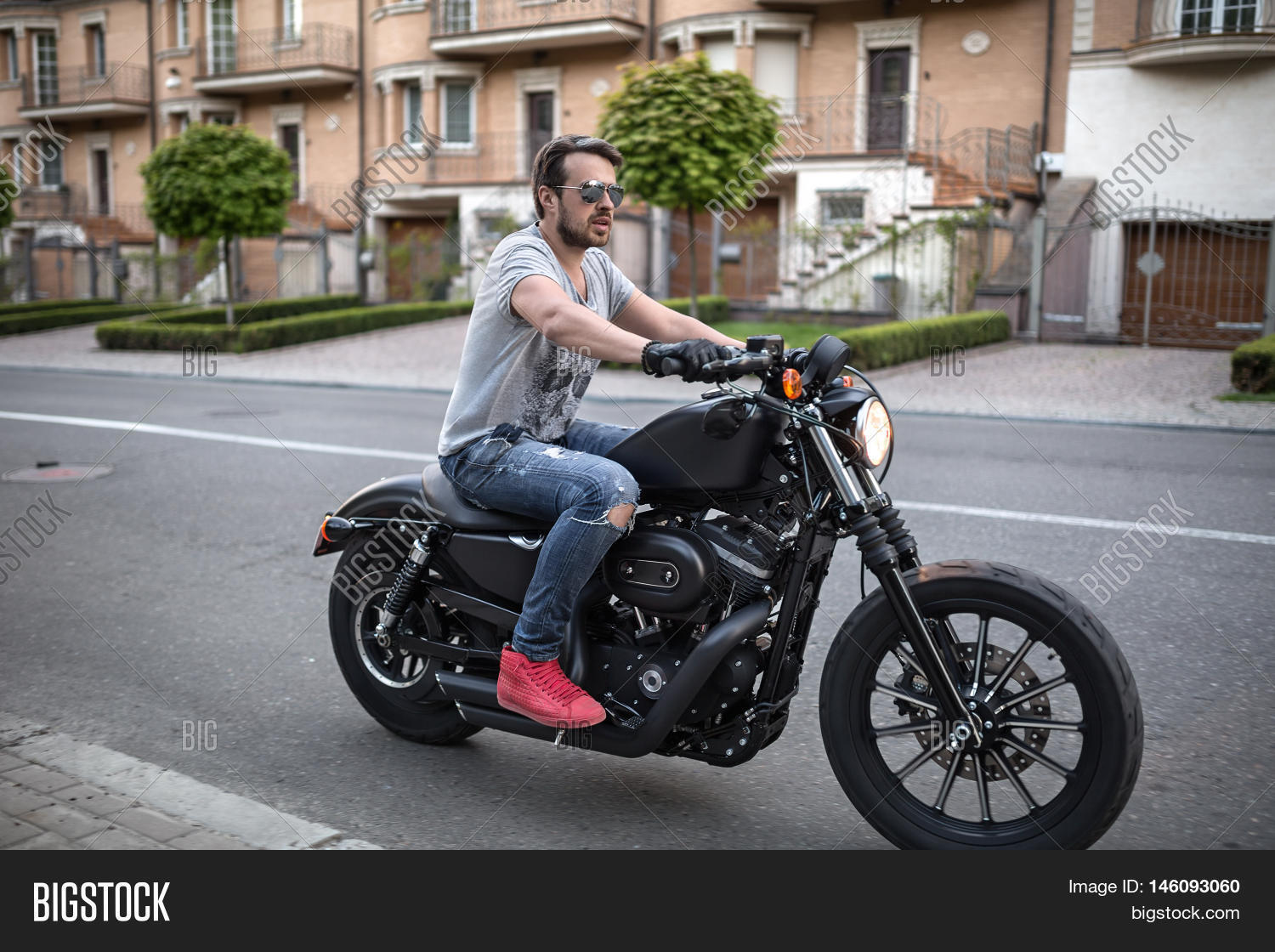 motorcycle background has  Handsome Man On Black Image