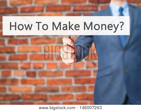 How To Make Money? - Businessman Hand Holding Sign