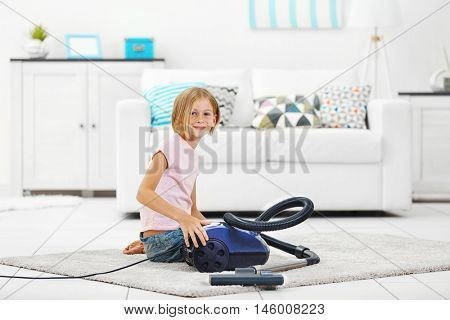 Little girl with hoover