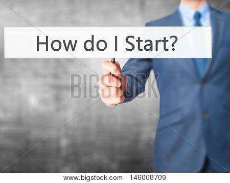How Do I Start? - Businessman Hand Holding Sign