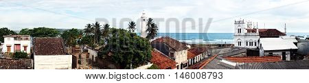 A view from roof of bilding inside Galle fort to lighthouse and the Indian ocean.
