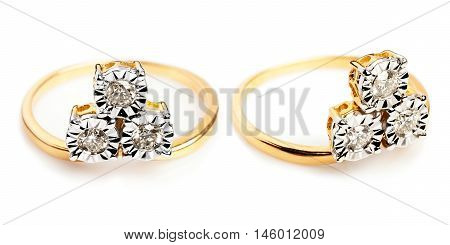 Close up of a Gold and Diamond rings having many diamonds and gem. Isolated on white background. Multiple views.