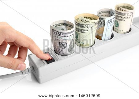Woman hand turning off power socket with dollars on white background