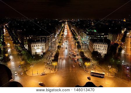 Avenue des Champs-Elysees as seen from Arc de Triomphe at night