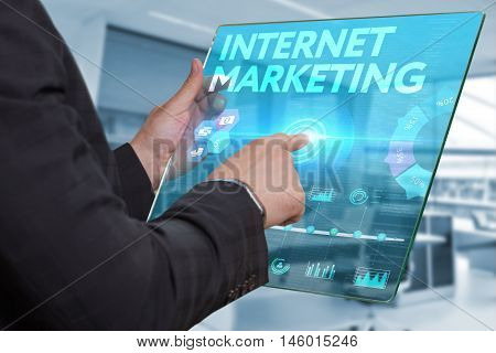 Internet. Business. Technology Concept. Businessman Presses A Button Internet  Marketing On The Virt