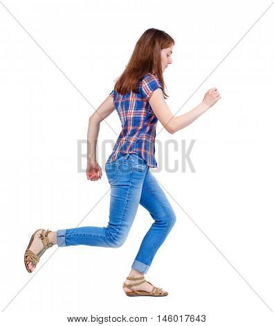side view of running woman. beautiful girl in motion. Girl in plaid shirt runs off to the side.