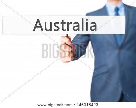 Australia - Businessman Hand Holding Sign
