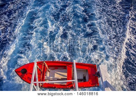 Lifeboat from the deck of a ship floating on the water