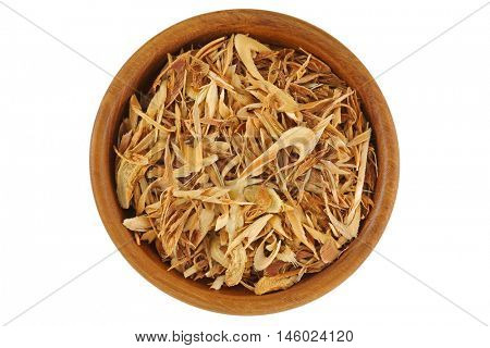 Top view of dried sliced Lemon grass to make tea, in wooden bowl isolated on white background.