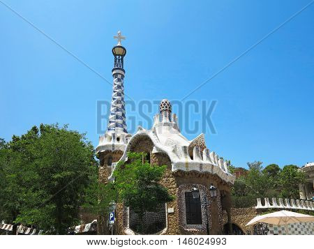 05.07.2016 Barcelona Spain: The entrance of Park Guell with the famous mosaics of Antonio Gaudi over blue sky background