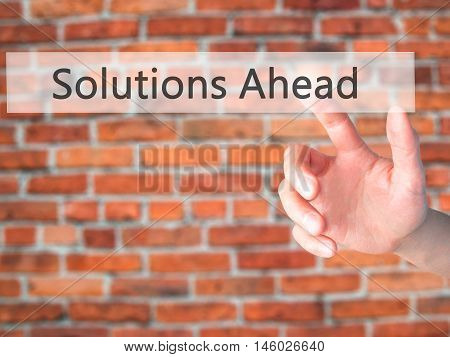 Solutions Ahead - Hand Pressing A Button On Blurred Background Concept On Visual Screen.