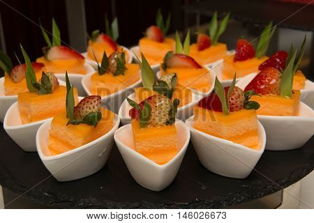 A Mini orang cakes and slices decoration strawberry