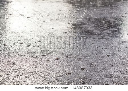 Rain flood in October. Water background of the rain.