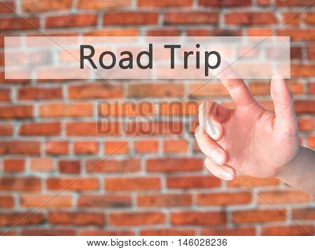 Road Trip - Hand Pressing A Button On Blurred Background Concept On Visual Screen.