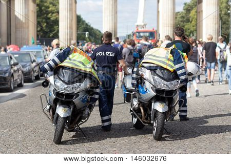 Policeman Officer Standing Next To Police Motorbikes