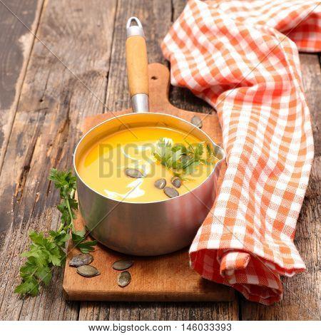 casserole with pumpkin soup on board
