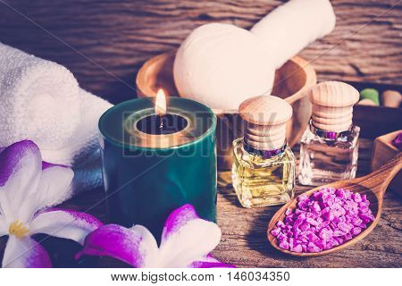 spa massage setting bottle of aroma essential oil Composition of spa treatment on table colorful background.