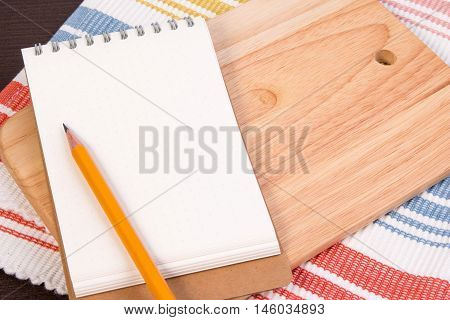 Notebook For Culinary Recipes On A Cutting Board With Napkin. Open Recipe Book On Wooden Background.