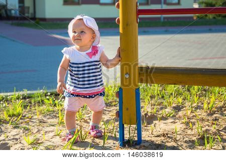 Little baby girl on public playground