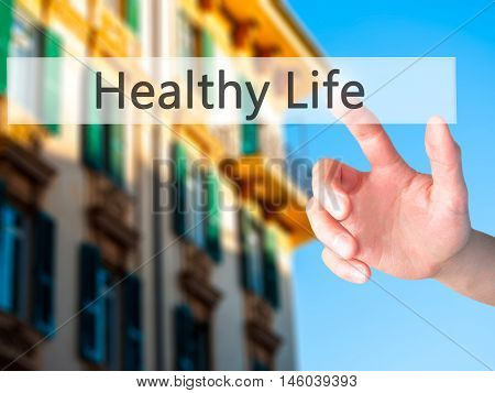 Healthy Life - Hand Pressing A Button On Blurred Background Concept On Visual Screen.