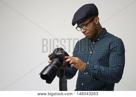 Studio Portrait Of Male Photographer With Camera
