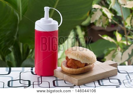 Spicy Chicken Burger on the wooden plate