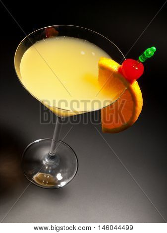 Cocktail Bronx with gin vermouth and orange juice. Isolated on black background shot from above
