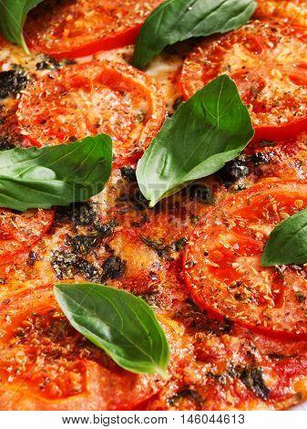 Margharita Pizza - with fresh tomatos mozzarella and basil close up vertical