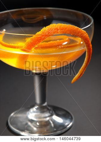 Satan Whiskers cocktail isolated on black background. Made from 1 oz gin 1/2 oz orange liqueur 1 oz dry vermouth 1 oz sweet vermouth 1 oz orange juice 2 dashes orange bitters