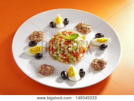 Tunisian salad with cucumbers tuna fish eggs and olives